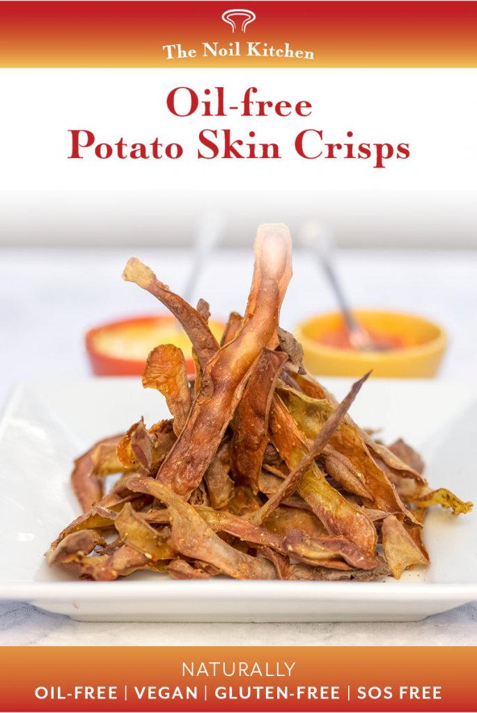 Oil-free Potato Skin Crisp pile high on a white square plate with two dip bowls behind