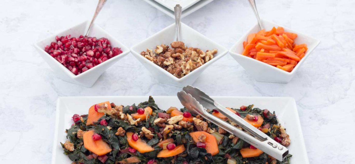 White rectangular plate with Swiss Chard & Persimmon Sautee with 3 dishes of toppings