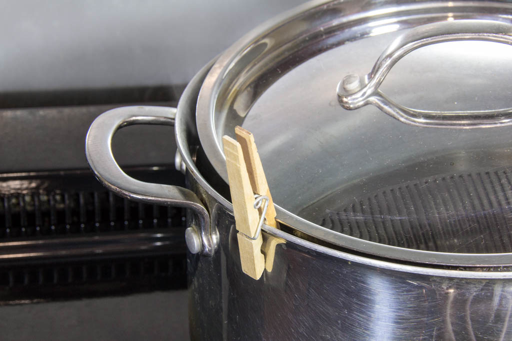 Separate the lid from the pot.