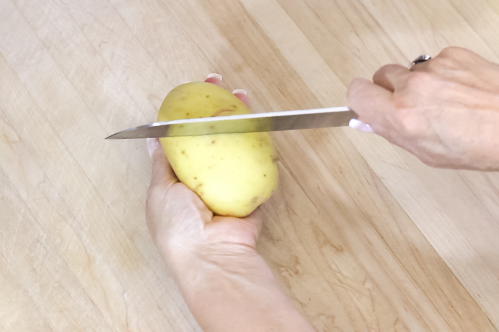 #2 Score the potato skin in different directions to keep skin on.