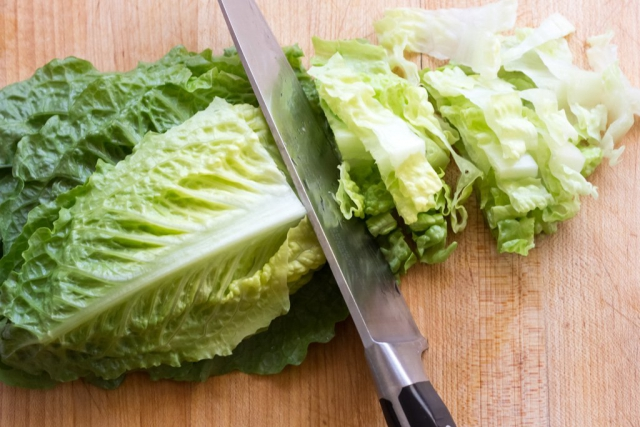 #5 Stack, roll and slice the romaine leaves into ribbons.