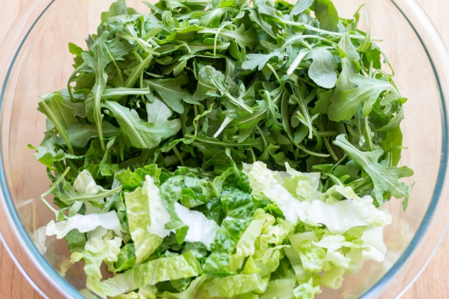 #7 Place the arugula and romaine ribbons in the bowl
