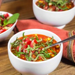 Oil-free vegan red pepper, chickpea and corn soup topped with homemade garden salsa fresca