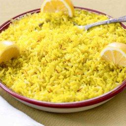 Shallow bowl with Saffron & Lemon Infused Basmati Rice garnished with 3 lemon wedges