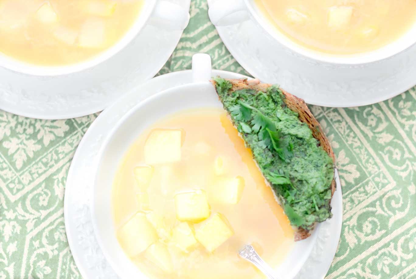 Three bowls of Fresh Springtime Garlic Soup with a parsley & cilantro pesto toast