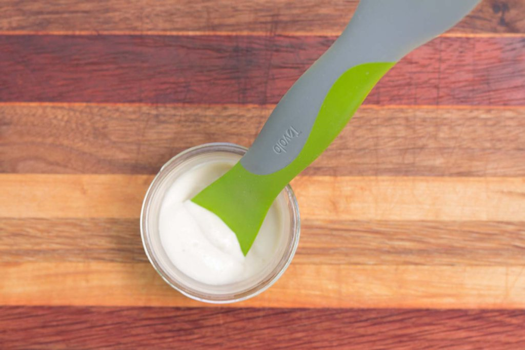 Tovolo Silicone Spatula in a jar containing oil-free vegan maynnaise.