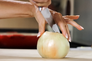 Place the onion with the largest flat side on the board