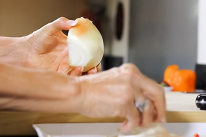Peel off the outer papery layers of the onion