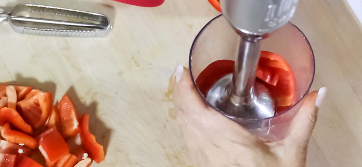 Kitchen Aid Hand Blender with a fresh red bell pepper in the cup ready to be blended.
