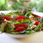 Heirloom Tomato & Basil Salad on an oval platter.