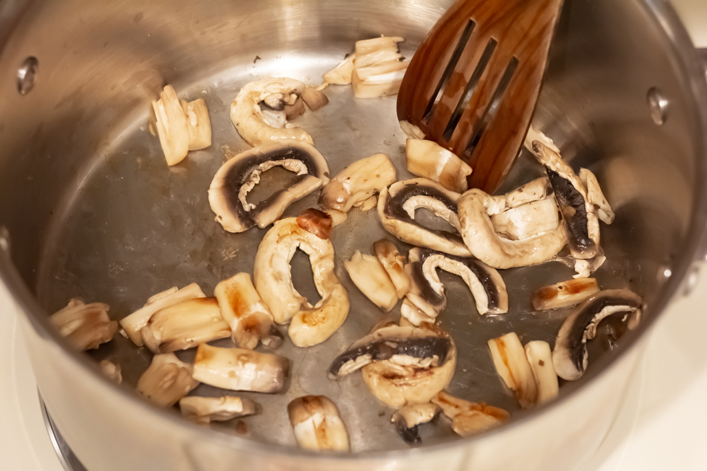 Add about 1/3 of the mushrooms to the pan and allow to brown a little.