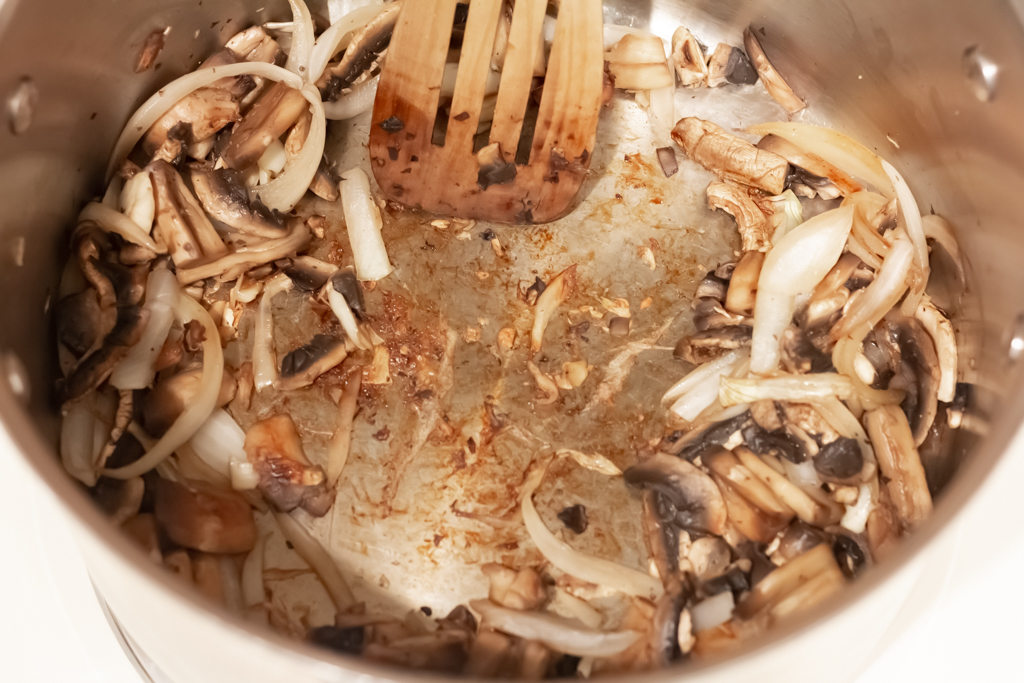 Allow the mushrooms and onions to caramelize, then push to the side of the pot.
