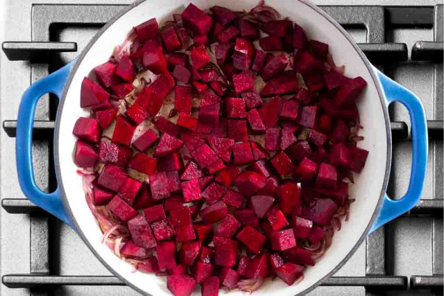 Diced beets added to the braiser pan to caramelize