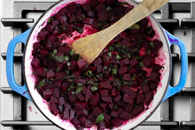 Balsamic vinegar added to the braiser pan with cooked beets and stalks